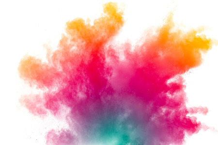 abstract multicolored powder splatter on white background. Freeze motion of color powder explosion on white background.