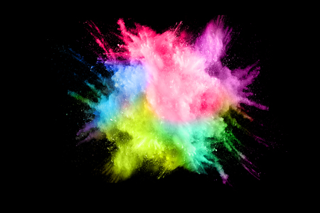 Multicolored powder explosion isolated on white background. Colored dust splash cloud  on white background. Launched colorful particles on background. Banque d'images