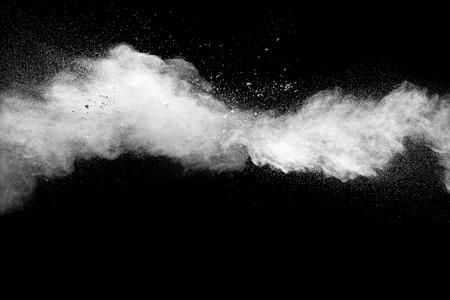 Launched white powder splash on black background. Stock Photo