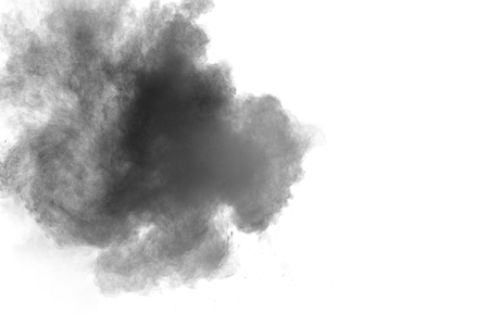 Closeup of black dust particles explode isolated on white background Imagens