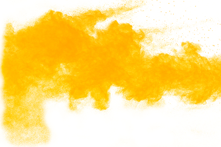 Yellow powder explosion on white background. Colored cloud. Colorful dust explode. Paint Holi.abstract multicolored dust splatter on white background Banque d'images - 115991769