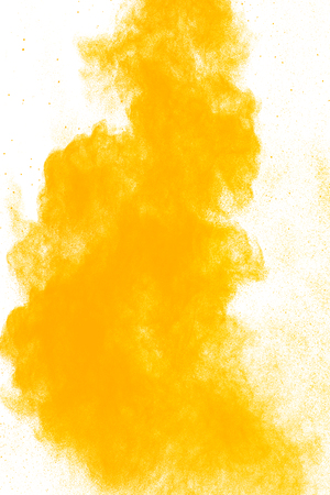 Yellow powder explosion on white background. Colored cloud. Colorful dust explode. Paint Holi.abstract multicolored dust splatter on white background Banque d'images - 115991771