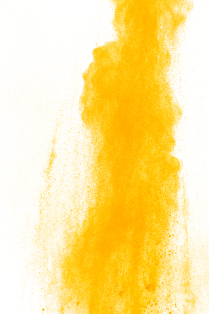 Yellow powder explosion on white background. Colored cloud. Colorful dust explode. Paint Holi.abstract multicolored dust splatter on white background Banque d'images - 115991789