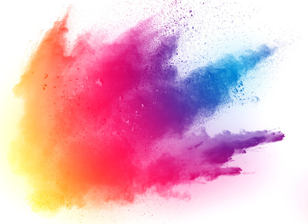 Multicolored powder explosion on white background. Colored cloud. Colorful dust explode. Paint Holi.abstract multicolored dust splatter on white background