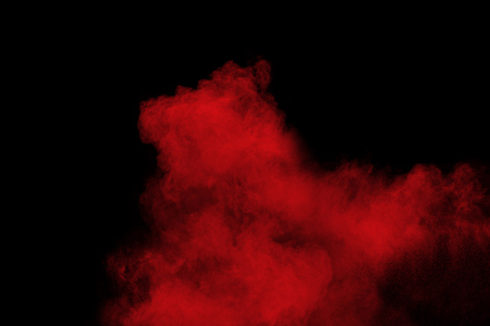 Red color powder explosion on black background.Freeze motion of red dust particles splashing. Banque d'images - 115992428