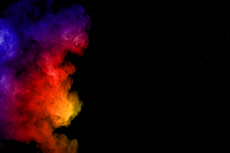 Abstract color powder explosion on black background.Freeze motion of dust splash. Painted Holi in festival. Banque d'images - 115992437