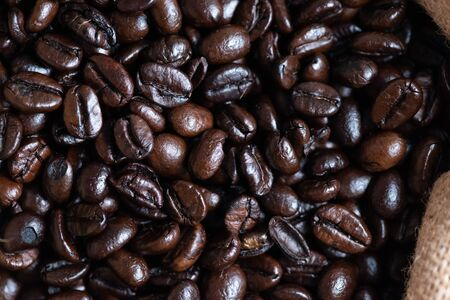 Roasted coffee beans texture, used as a background.Flat lay, top view, copy space. 스톡 콘텐츠 - 149298000