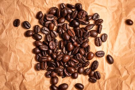 Roasted coffee beans texture, used as a background.Flat lay, top view, copy space.