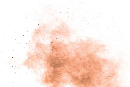 Freeze motion of brown powder exploding. Abstract design of brown dust cloud against white background.