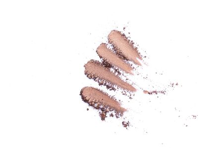 Deep brown crumbled eye shadow isolated on white background.Splatter make up and cosmetic products. 스톡 콘텐츠 - 149298059