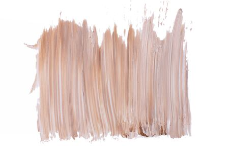 Lipstick smear smudge swatch isolated on white background. Cream makeup texture. Bright biege color cosmetic product brush stroke swipe sample. 스톡 콘텐츠