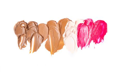 Texture of lipstick isolated on white background. Smear of lip gloss on a white background.