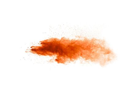Abstract yellow orange powder explosion on white background. Freeze motion of yellow orange dust particles splash.