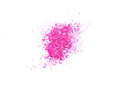 Pink crushed eye shadow isolated on white background. Splatter make up and cosmetic products.