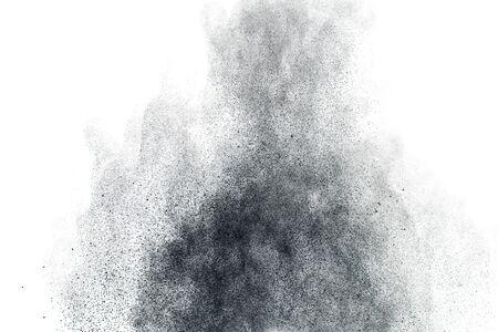 Black powder splatter background.Dust particles texture. 스톡 콘텐츠