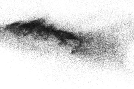 Black powder explosion against white background. Black dust particles splashing.
