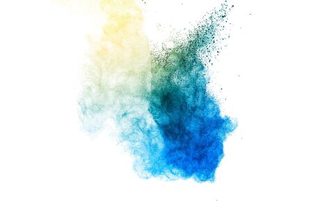 Explosion of blue and yellow dust on white background.