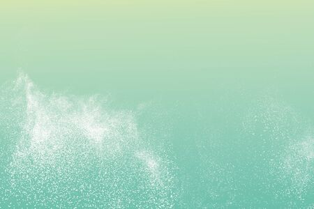 White powder explosion against green background.