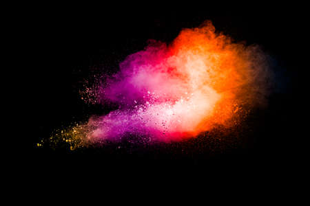 Explosion of colorful pigment powder on black background.Vibrant color dust particles textured background. Stock fotó