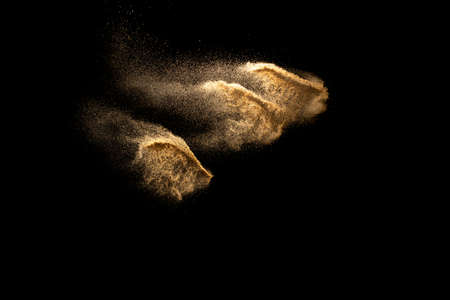 Abstract cloud motion blurred sand background.Sandy explosion isolated on over dark background.