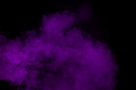 Abstract purple powder explosion on black background, Freeze motion of purple dust splashing. Foto de archivo