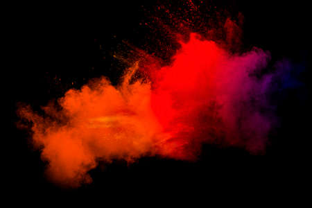 Abstract blurred motion of colorful dust particles on black background.Abstract hot tone color powder overlay texture.