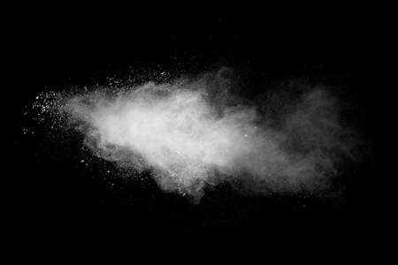 White powder explosion isolated on black background. White dust particles splash.Color Holi Festival. Foto de archivo - 152503536