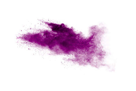 Pink powder explosion.Closeup of Pink dust particle explosion isolated on  white background.