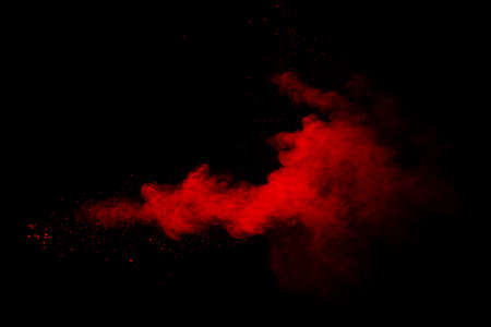 Abstract red powder on black background. Red color clouds. Stock fotó