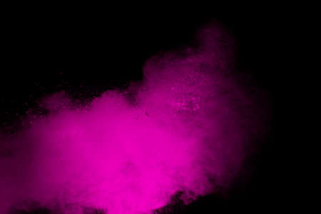 Pink powder explosion isolated on black background. Foto de archivo