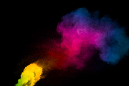 Abstract multi color powder explosion on black background.  Freeze motion of colorful dust  particles splash. Painted Holi. 免版税图像