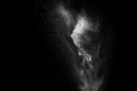 White powder explosion clouds.Freeze motion of white dust particles on black background.