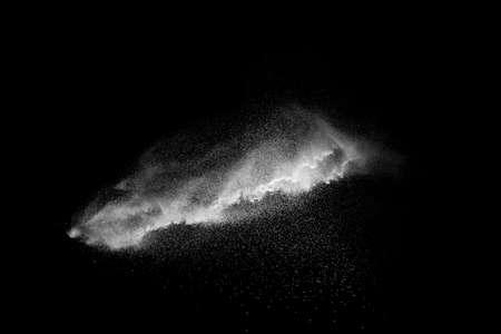 White talcume powder explosion on black background. White dust particles splash.