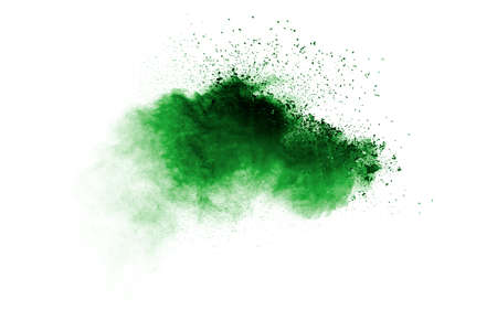 Abstract green dust explosion on white background. Abstract green powder splattered on background. 免版税图像