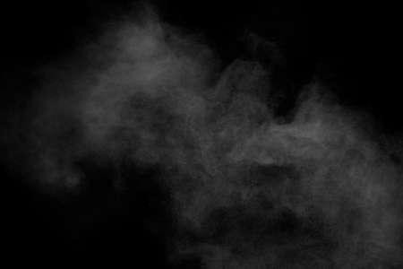 White powder explosion clouds.Freeze motion of white dust particles splash on black background.