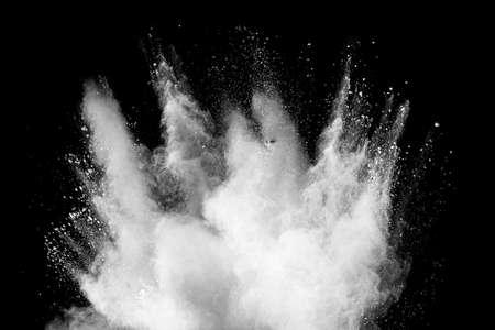 Freeze motion of white dust particles splash on black background.