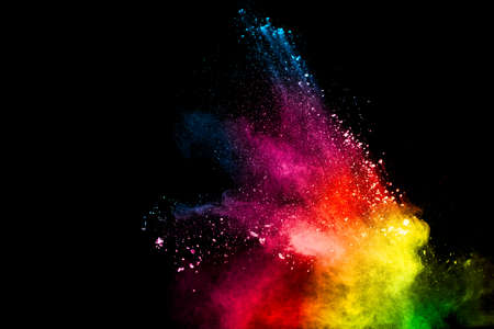 Abstract colorful powder explosion on black background.Freeze motion of dust splash.Painted Holi. Foto de archivo