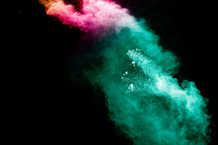 Abstract multi color powder explosion on black background. Foto de archivo