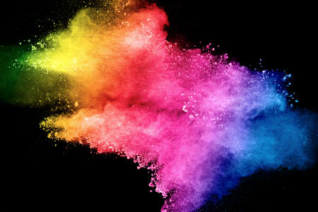Pastel color dust particle splashing.Colorful powder explosion on blackackground.