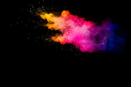 Explosion of multicolored powder isolated on black background. Foto de archivo