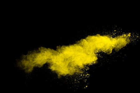 Freeze motion of yellow orange dust particles splash