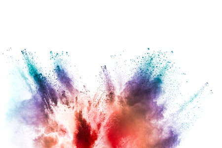 Freeze motion of colored powder explosions isolated on white background. Foto de archivo