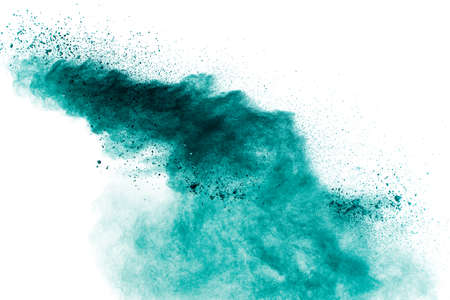 Abstract green powder explosion on white background.Freeze motion of green dust cloud. Foto de archivo