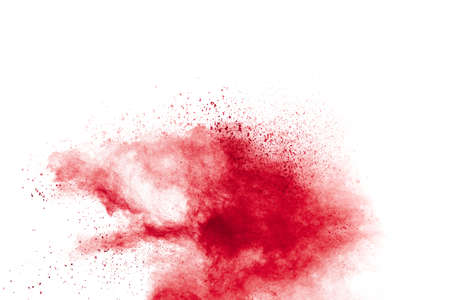 Red powder explosion on white background. Freeze motion of red dust particles splash.
