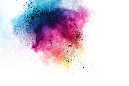 Abstract multi color powder explosion on white background. Freeze motion of colorful dust  particles splash.