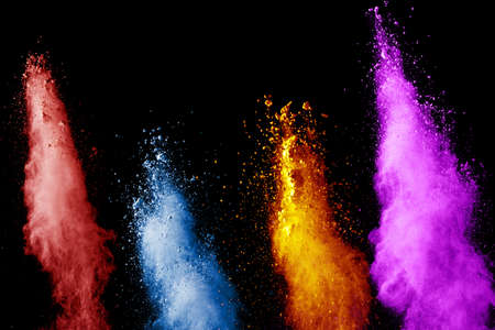 abstract color powder explosion on black background.abstract  Freeze motion of color dust  particles splash.