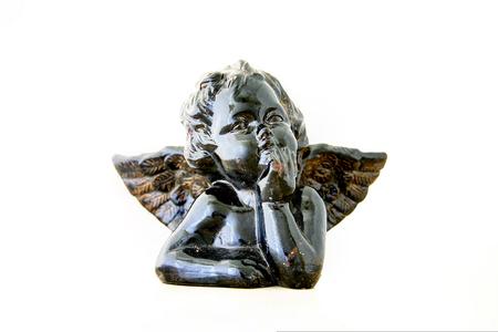 Black little angel sculpture Stock Photo