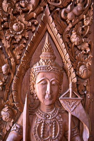 Wood carving on the window of the temple in Thailand photo