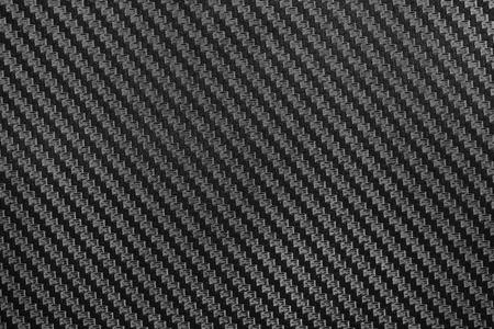 gunmetal: Black Carbon fiber texture closeup background. Industrial carbon fiber texture