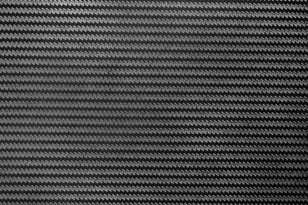 Black Carbon fiber texture closeup background. Industrial carbon fiber texture